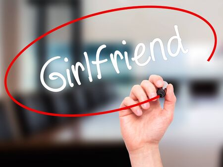 desertion: Man Hand writing Girlfriend with black marker on visual screen. Isolated on office. Business, technology, internet concept.