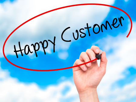 cause marketing: Man Hand writing Happy Customer with black marker on visual screen. Isolated on sky. Business, technology, internet concept. Stock Photo