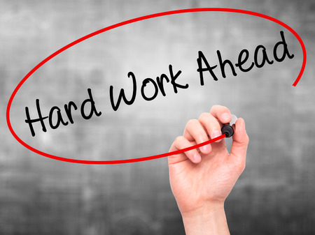 hard work ahead: Man Hand writing Hard Work Ahead with black marker on visual screen. Isolated on grey. Business, technology, internet concept. Stock Photo Stock Photo
