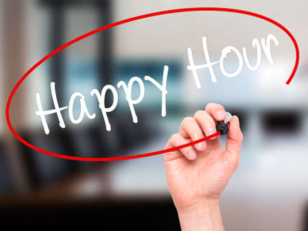 happyhour: Man Hand writing Happy Hour with black marker on visual screen. Isolated on office. Business, technology, internet concept. Stock Image