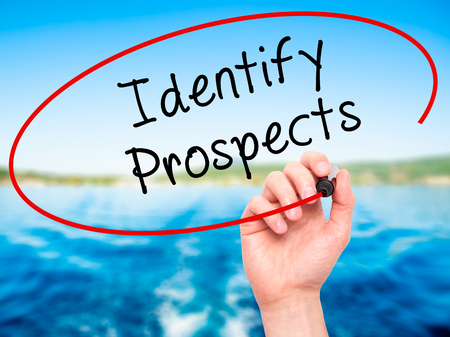 the prospects: Man Hand writing Identify Prospects with black marker on visual screen. Isolated on nature. Business, technology, internet concept. Stock Photo