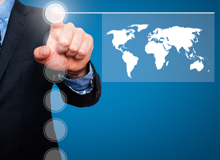 earth in hands: Businessman in dark suit pushing button worldmap global communication