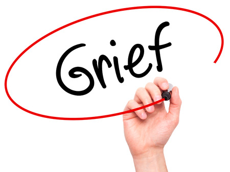 vexation: Man Hand writing Grief with black marker on visual screen. Isolated on background. Business, technology, internet concept. Stock Photo