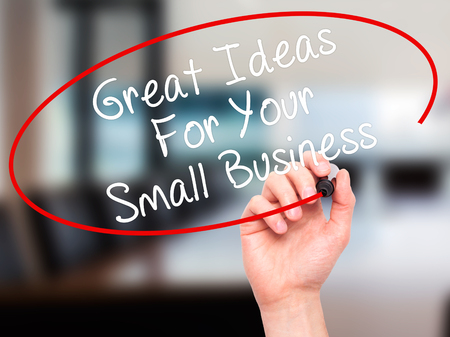 business ideas: Man Hand writing Great Ideas For Your Small Business with black marker on visual screen. Isolated on office. Business, technology, internet concept. Stock Photo