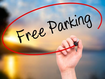 sunroof: Man Hand writing Free Parking with black marker on visual screen. Isolated on nature. Business, technology, internet concept. Stock Photo