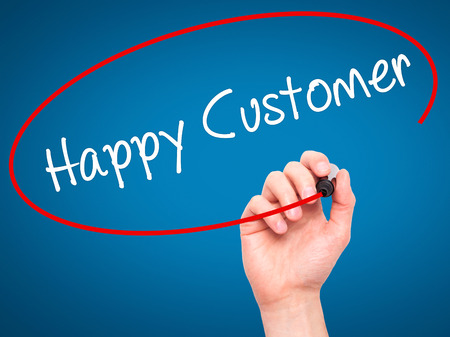 cause marketing: Man Hand writing Happy Customer with black marker on visual screen. Isolated on blue. Business, technology, internet concept. Stock Photo Stock Photo