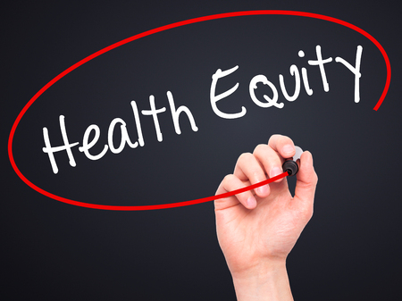 health equity: Man Hand writing Health Equityt with black marker on visual screen. Isolated on black. Business, technology, internet concept. Stock Photo Stock Photo