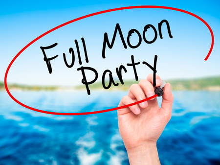 rin: Man Hand writing Full Moon Party with black marker on visual screen. Isolated on nature. Business, technology, internet concept. Stock Image Stock Photo