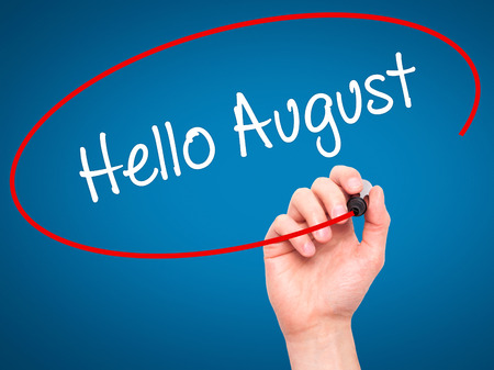 hi back: Man Hand writing Hello August with black marker on visual screen. Isolated on blue. Business, technology, internet concept. Stock Photo