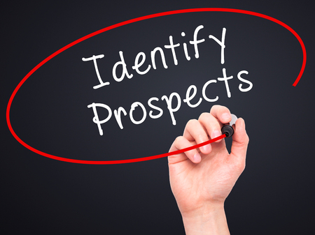 efficacy: Man Hand writing Identify Prospects with black marker on visual screen. Isolated on black. Business, technology, internet concept. Stock Photo Stock Photo