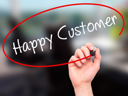 cause marketing: Man Hand writing Happy Customer with black marker on visual screen. Isolated on office. Business, technology, internet concept. Stock Photo