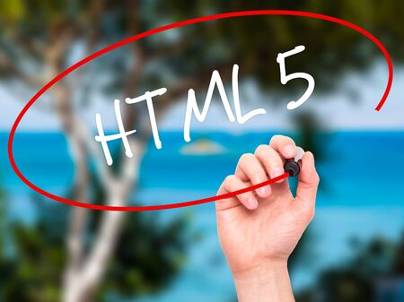 html 5: Man Hand writing HTML 5 with black marker on visual screen. Isolated on nature. Business, technology, internet concept. Stock Photo