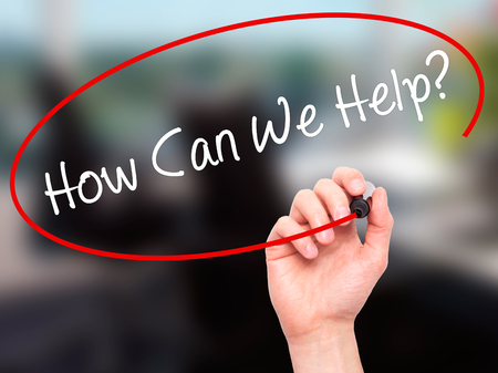 can we help: Man Hand writing How Can We Help? with black marker on visual screen. Isolated on background. Business, technology, internet concept. Stock Photo