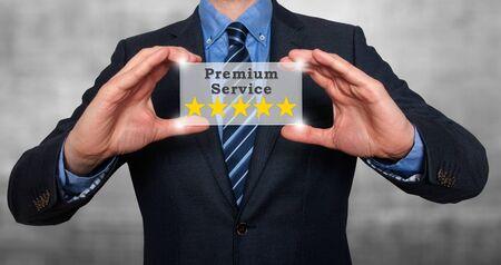 Businessman holds five stars premium service. Grey - Stock Photo