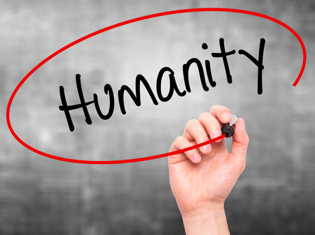 mercifulness: Man Hand writing Humanity  with black marker on visual screen. Isolated on background. Business, technology, internet concept. Stock Photo