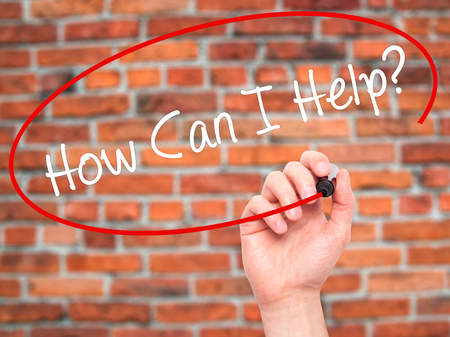 raising cans: Man Hand writing How Can I Help? with black marker on visual screen. Isolated on bricks. Business, technology, internet concept. Stock Photo