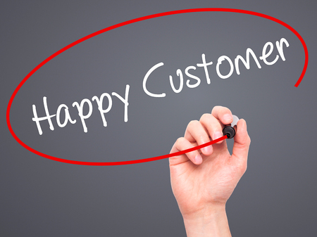 cause marketing: Man Hand writing Happy Customer with black marker on visual screen. Isolated on grey. Business, technology, internet concept. Stock Photo
