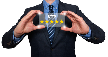 five star: Businessman holding five star rating VIP - White - Stock Image Stock Photo