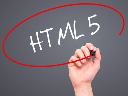 html 5: Man Hand writing HTML 5 with black marker on visual screen. Isolated on grey. Business, technology, internet concept. Stock Photo