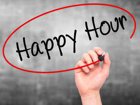 happyhour: Man Hand writing Happy Hour with black marker on visual screen. Isolated on grey. Business, technology, internet concept. Stock Image