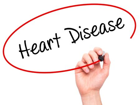 arrhythmias: Man Hand writing Heart Disease with black marker on visual screen. Isolated on white. Business, technology, internet concept. Stock Photo Stock Photo
