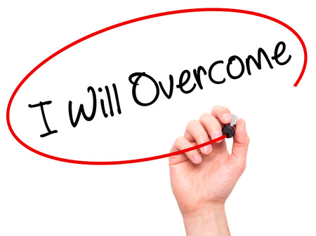 failed politics: Man Hand writing I Will Overcome with black marker on visual screen. Isolated on white. Business, technology, internet concept. Stock Photo