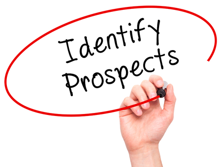 prospecting: Man Hand writing Identify Prospects with black marker on visual screen. Isolated on white. Business, technology, internet concept. Stock Photo