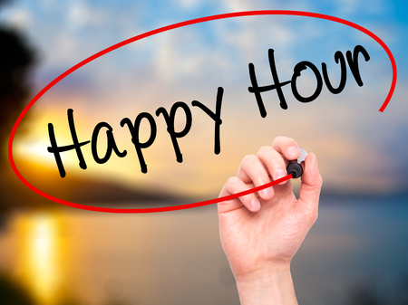 happyhour: Man Hand writing Happy Hour with black marker on visual screen. Isolated on nature. Business, technology, internet concept. Stock Image