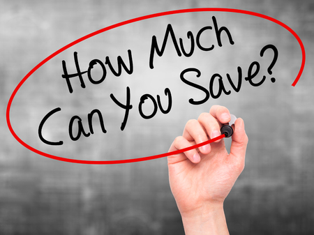 mortgaging: Man Hand writing How Much Can You Save? with black marker on visual screen. Isolated on grey. Business, technology, internet concept. Stock Photo