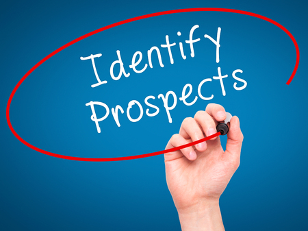 the prospects: Man Hand writing Identify Prospects with black marker on visual screen. Isolated on blue. Business, technology, internet concept. Stock Photo Stock Photo