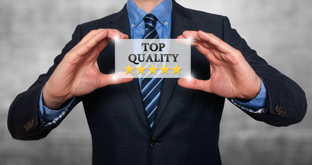 commitment committed: TOP Quality with five stars - Businessman with sign - Grey - Stock Photo