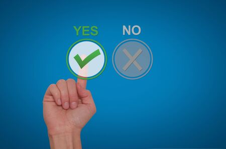 assent: Hand Choose yes on virtual screen. Business technology concept. Isolated on blue. Stock Image.