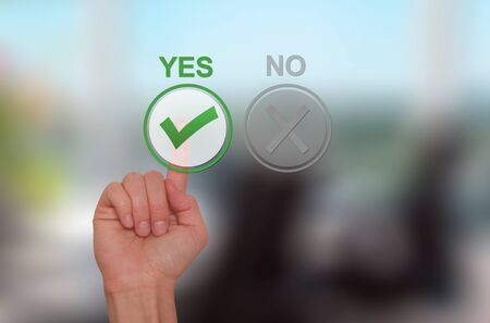 assent: Hand Choose yes on virtual screen. Business technology concept. Isolated on office. Stock Image.