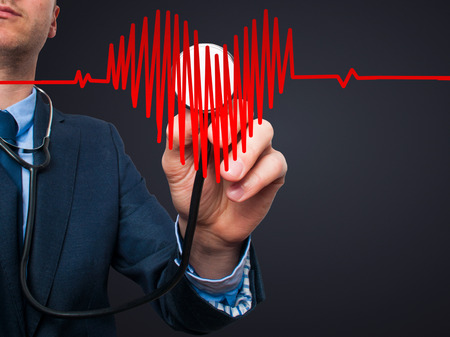 preventive medicine: Closeup portrait handsome business man, male corporate employee, worker listening to  heart with stethoscope isolated on black background. Preventive medicine, financial condition check-up concept