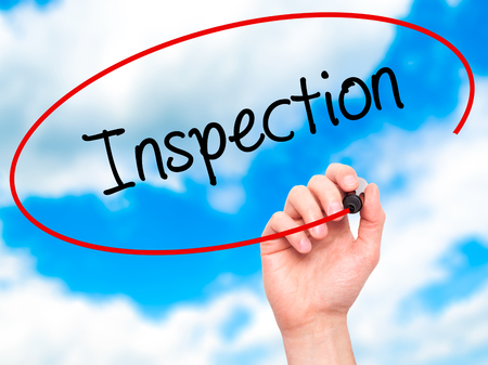 warranty questions: Man Hand writing Inspection with black marker on visual screen. Isolated on sky. Business, technology, internet concept. Stock Photo
