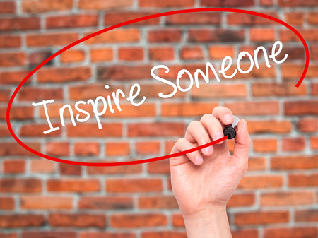 someone: Man Hand writing Inspire Someone  with black marker on visual screen. Isolated on background. Business, technology, internet concept. Stock Photo Stock Photo