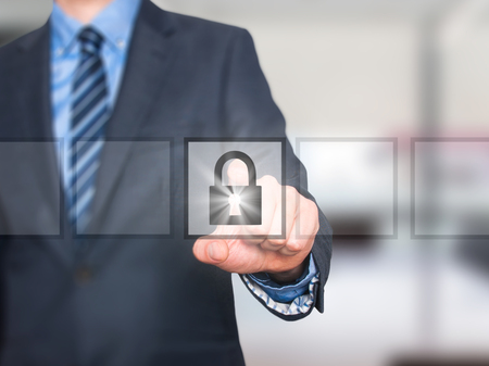 business security: Businessman selecting padlock. Business security concept. Isolated on office. Stock Image
