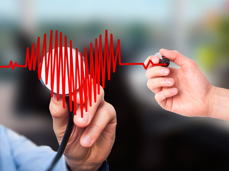 Closeup portrait doctor hand listening to heart beat in heart shape with stethoscope isolated on office background. Preventive medicine concept