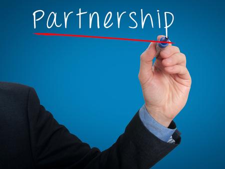 Business man writing partnership concept. Blue - Stock Photo