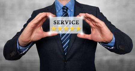 five stars: Businessman holding white card with Service Five Stars sign, Grey - Stock Photo Stock Photo