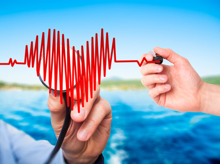 preventive medicine: Closeup portrait doctor hand listening to heart beat in heart shape with stethoscope isolated on nature  background. Preventive medicine concept