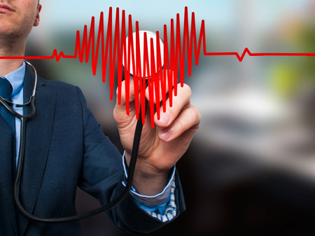 preventive medicine: Closeup portrait handsome business man, male corporate employee, worker listening to  heart with stethoscope isolated on office background. Preventive medicine, financial condition check-up concept