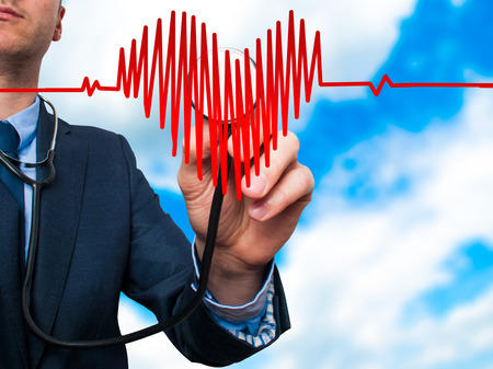 preventive medicine: Closeup portrait handsome business man, male corporate employee, worker listening to  heart with stethoscope isolated on sky background. Preventive medicine, financial condition check-up concept Stock Photo