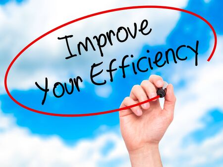 accomplishing: Man Hand writing Improve Your Efficiency with black marker on visual screen. Isolated on background. Business, technology, internet concept. Stock Photo Stock Photo