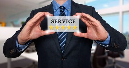 quality work: Businessman holding white card with Service Five Stars sign, Office- Stock Photo
