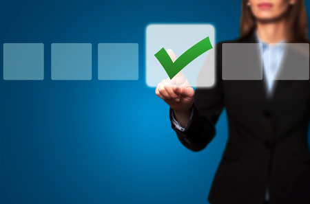 business decisions: Businesswoman Touching Button and Ticking Check Box