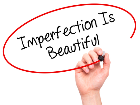imperfection: Man Hand writing Imperfection Is Beautiful with black marker on visual screen. Isolated on background. Business, technology, internet concept. Stock Photo