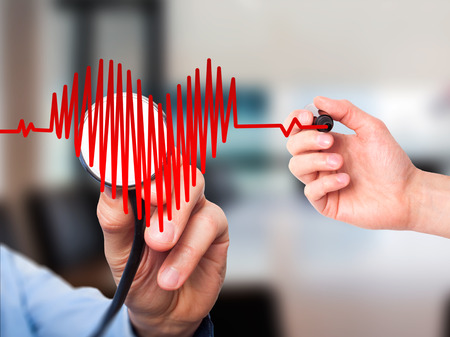 preventive medicine: Closeup portrait doctor hand listening to heart beat in heart shape with stethoscope isolated on office background. Preventive medicine concept