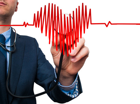 medicaid: Closeup portrait handsome business man, male corporate employee, worker listening to  heart with stethoscope isolated on white background. Preventive medicine, financial condition check-up concept Stock Photo