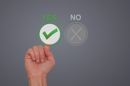 assent: Hand Choose yes on virtual screen. Business technology concept. Isolated on grey. Stock Image.
